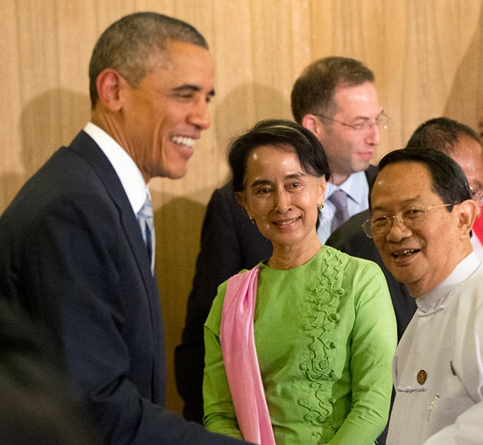 Myanmar's opposition leader Aung San Suu Kyi, looks at U.S. President Barack Obama, greet participants following a meeting at Parliamentary Resource Center, in Naypyitaw, Myanmar..