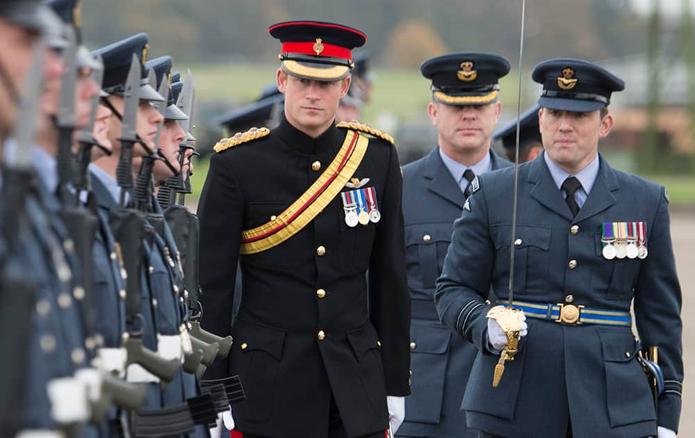 Britain's Prince Harry, Honorary Air Commandant, inspects No 26 squadron RAF Regiment during a presentation of a new standard at Royal Air Force Honington, Bury St Edmunds, England.