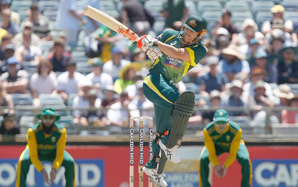 Australia's David Warner plays a hook shot during their one day international cricket match against South Africa in Perth, Australia.