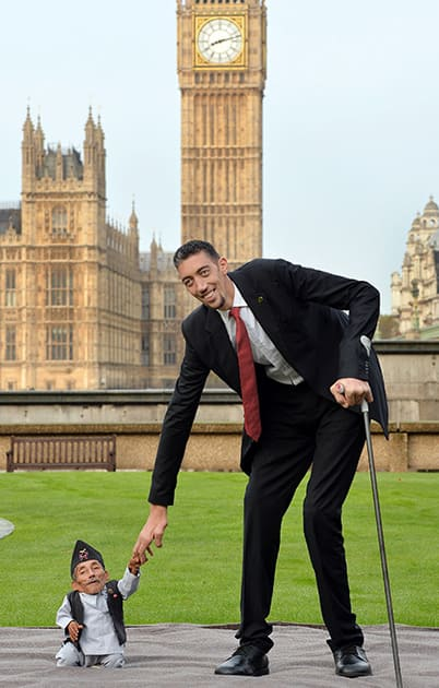 Chandra Dangi, who is 21.5 inches tall, with Sultan Kosen, who is 8 feet 3 inches tall, at a photocall to celebrate the 10th annual Guinness World Records Day in Westminster, London.