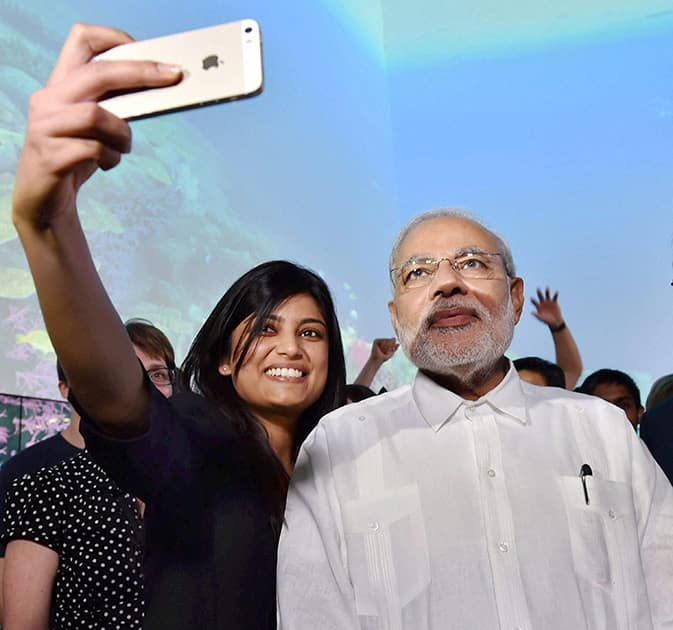 Prime Minister Narendra Modi poses for a photo with students during a visit to Queensland University of Technology in Brisbane, Australia.