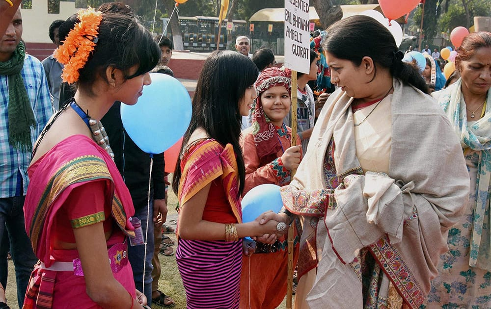 HRD Minister Smriti Irani interacts with children during Bal Diwas celebrations at Bal Bhavan.