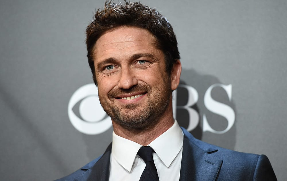 Gerard Butler poses in the press room with the Hollywood animation award for