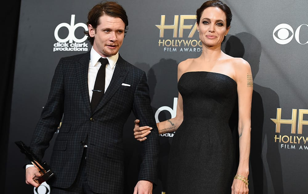 Jack O'Donnell, winner of the new Hollywood award, and Angelina Jolie pose in the press room at the Hollywood Film Awards at the Palladium in Los Angeles.