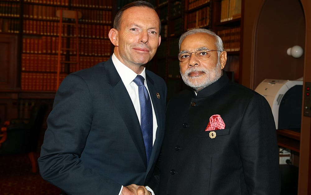 Australia's Prime Minister Tony Abbott and India's Prime Minister Narendra Modi in the Reading Room at Parliament House during the G-20 Leaders' Summit in Brisbane, Australia.
