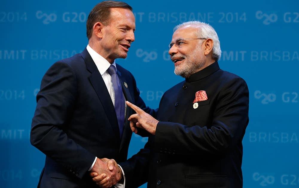 Australian Prime Minister Tony Abbott greets Indian Prime Minister Narendra Modi at the G20 in Brisbane, Australia.