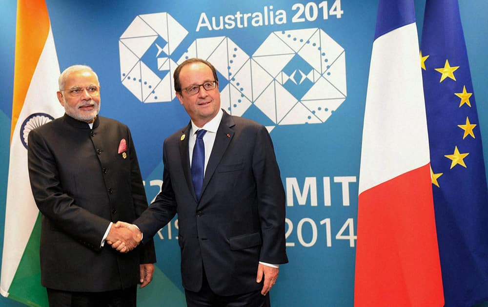 Prime Minister Narendra Modi shakes hands with President of France, Francois Hollande during a meeting at the G20 Summit in Brisbane, Australia.