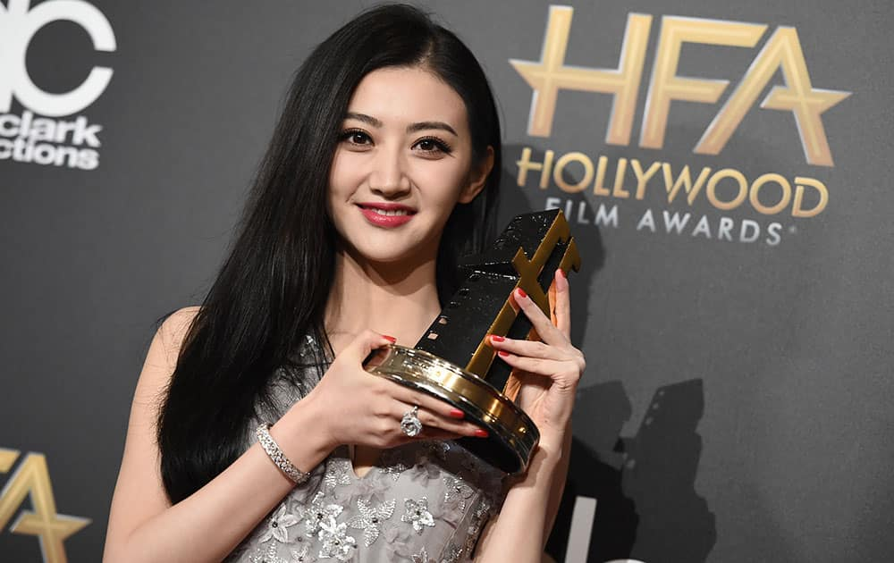Tian Jing poses in the press room with the Hollywood international award at the Hollywood Film Awards at the Palladium in Los Angeles.