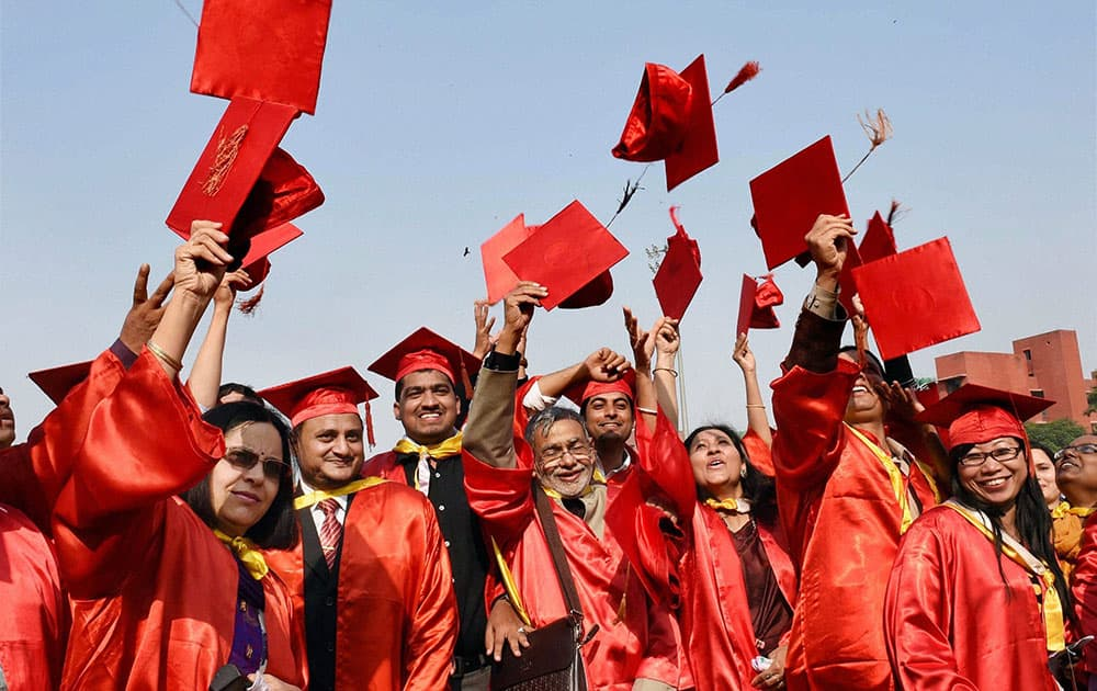 Students jubilate after receiving degree and citations during the annual convocation of Jamia Millia Islamia in New Delhi.