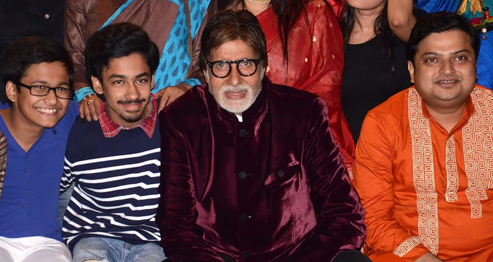 Bollywood megastar Amitabh Bachchan poses with actors during launch of new Bengali film.