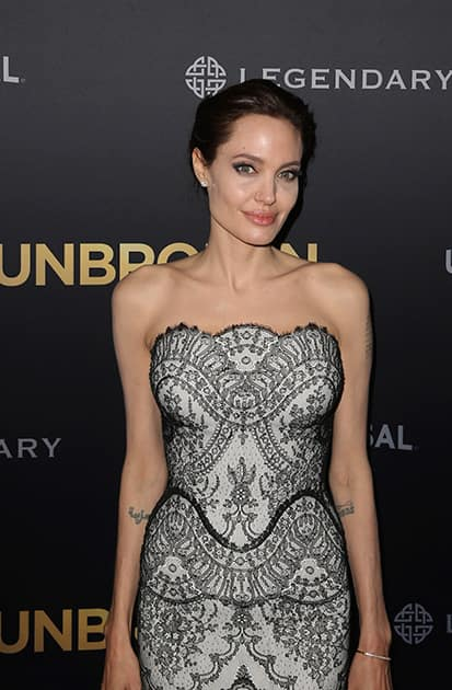 Angelina Jolie, director of 'Unbroken', poses for photos at World Premiere of her film in Sydney.