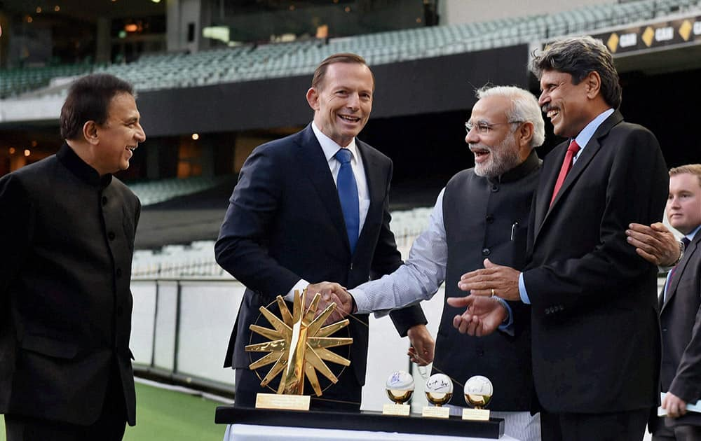 Prime Minister Narendra Modi and his Australian counterpart Tony Abbott with legendary cricketers Kapil Dev and Sunil Gavaskar during a function at Melbourne Cricket Ground in Melbourne.