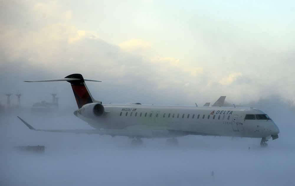 Lake-effect snow storm with freezing temperatures affected travel, like this plane that negotiated its way through the snow at Buffalo Greater International Airport, in Buffalo, N.Y.