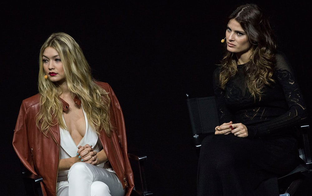 Models Gigi Hadid (left) and Isabeli Fontana attend the presentation of the Pirelli 2015 Calendar by Steven Meisel, unveiled in Milan.