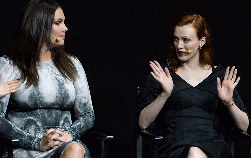 Models Candice Huffine (left) and Karen Elson attend the presentation of the Pirelli 2015 Calendar by Steven Meisel, unveiled in Milan.