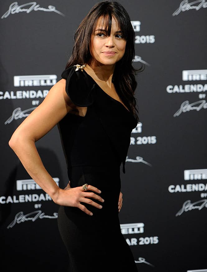 Actress Michelle Rodriguez poses for the photographers as she arrives at the Gala Dinner on the occasion of the presentation of the Pirelli 2015 Calendar by Steven Meisel, unveiled in Milan.