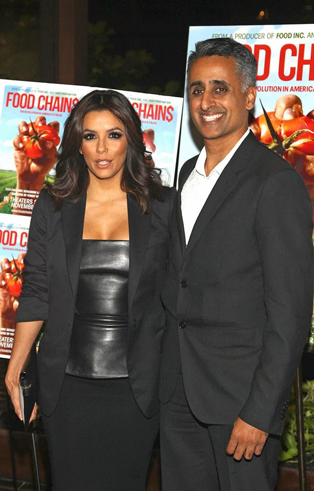Actress Eva Longoria and director Sanjay Rawal attend the premiere of Food Chains, at the The Food Foundation in New York.