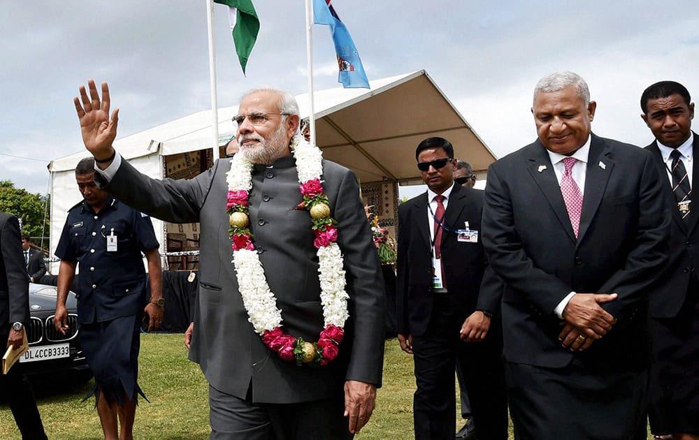 Prime Minister Narendra Modi with his Fijian counterpart Josaia Voreqe Bainimarama during a traditional welcome ceremony at Albert Square in Fiji.