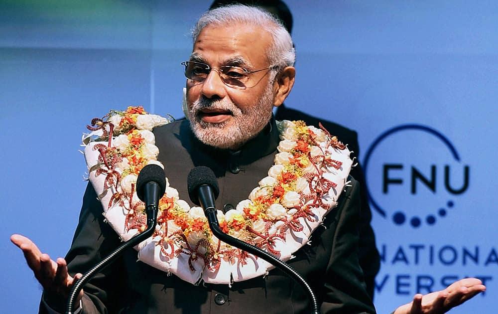 Prime Minister Narendra Modi speaks during a function at Fiji National University in Suva.