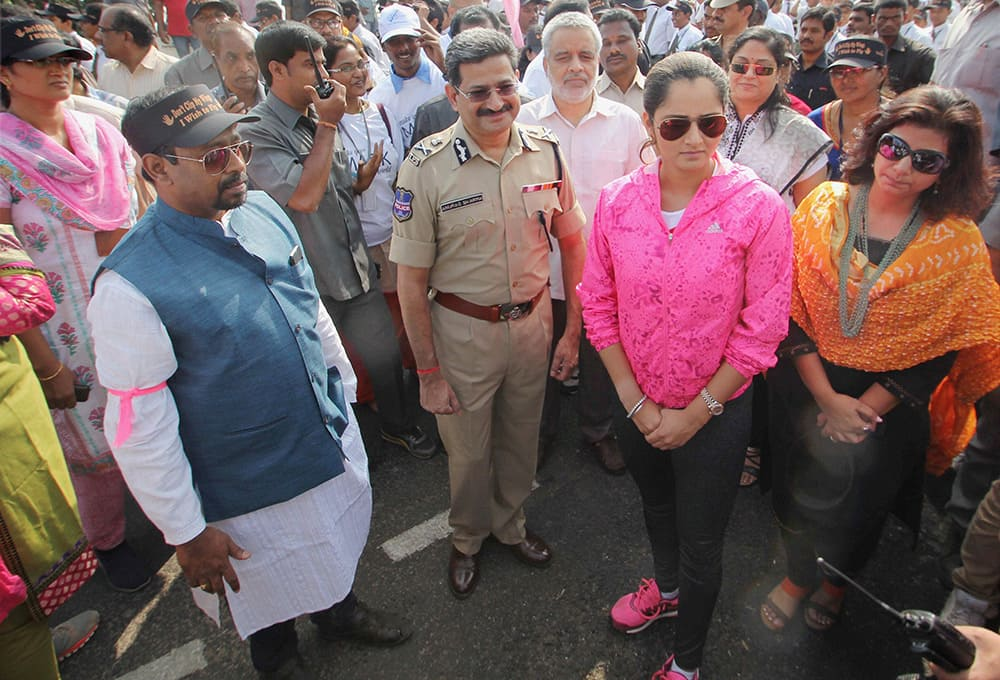 Tennis star Sania Mirza with Chief Secretary of Telangana Ajay Sharma and Hyderabad Police Commissioner Anurag Sharma at an Anti Child sex-abuse rally in Hyderabad.