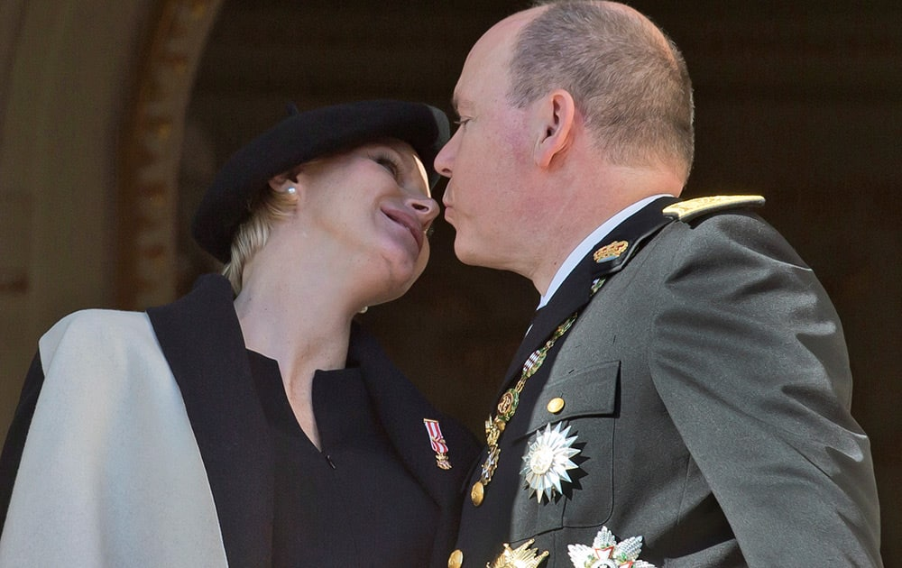 Prince Albert II of Monaco kisses his wife Princess Charlene on the balcony of the Monaco palace during the Monaco's national day ceremony.