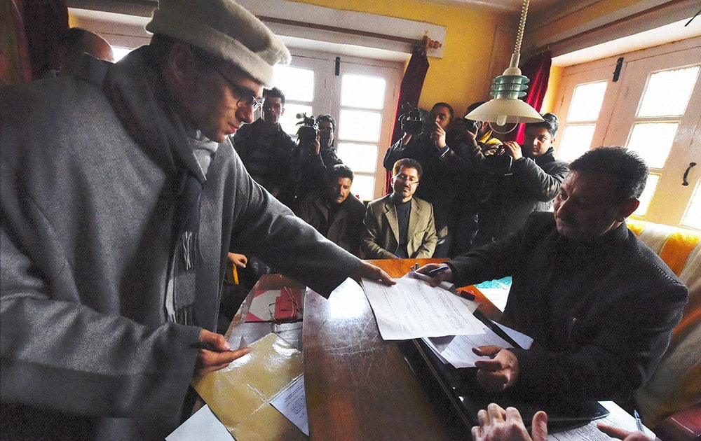 Jammu and Kashmir Chief Minister and National Conference working president Omar Abdullah filling nomination papers for Assembly elections at Beerwah in Budgam district.