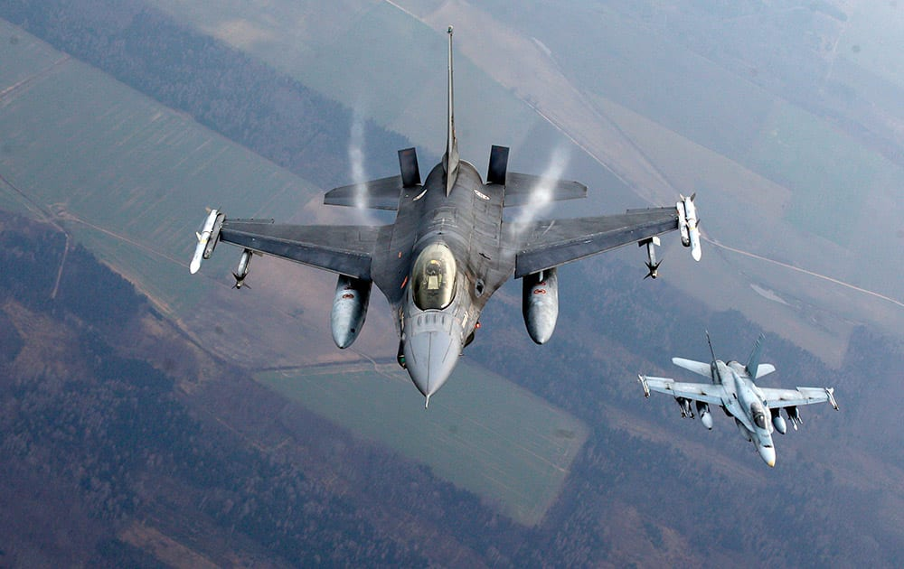 A Portuguese military fighter jet and a Canadian military fighter jet participating in NATO's Baltic Air Policing Mission operate in Lithuanian airspace, NATO, which has 16 fighter jets in the region monitoring Baltic airspace, said it regularly launches jets to identify 'unknown or potentially hostile aircraft' in the proximity of national airspace.