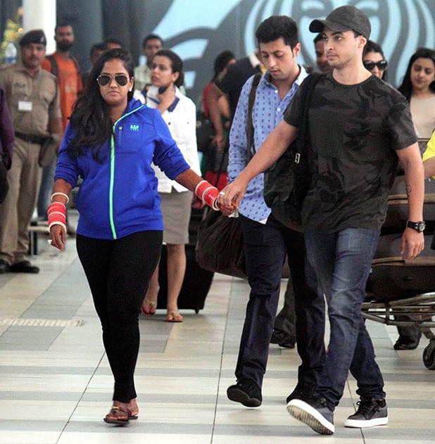 Newly wed couple Arpita Khan and Aayush Sharma come at domestic airport Santacruz in Mumbai after their wedding in Hyderabad.