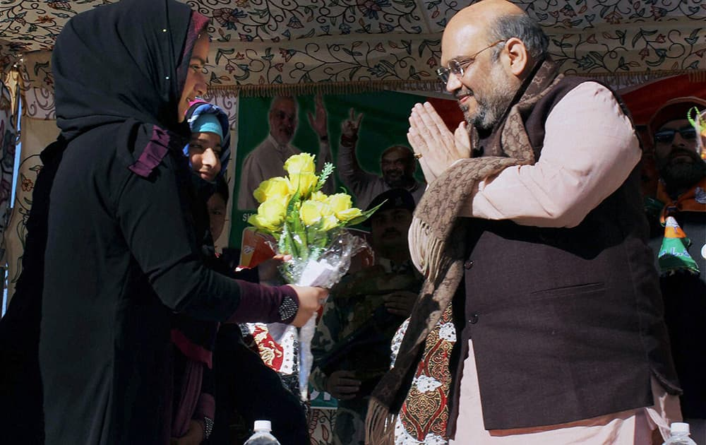 BJP President Amit Shah is greeted at an election rally in Banihal, J & K.