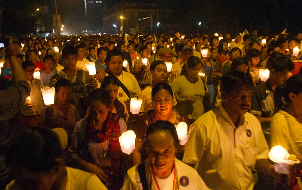 Myanmar Christians holding candles walk as they take part in a ceremony to mark the 500th anniversary of the Roman Catholic Church's arrival to Myanmar at Saint Mary Cathedral, in Yangon, Myanmar.