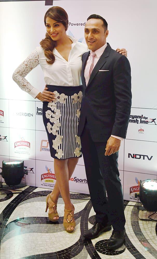 Actress Bipasha Basu and Rahul Bose arrive at the Airtel Marathon Redcarpet event in New Delhi.