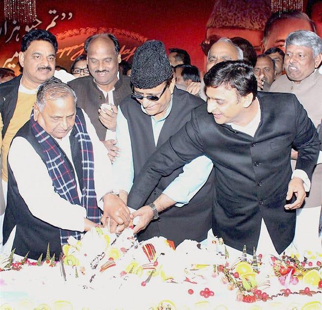 Samajwadi Party supremo Mulayam Singh Yadav with Uttar Pradesh Chief Minister Akhilesh Yadav and Azam Khan cutting cake on the occassion of Mulayam Singh Yadavs 76th birthday.