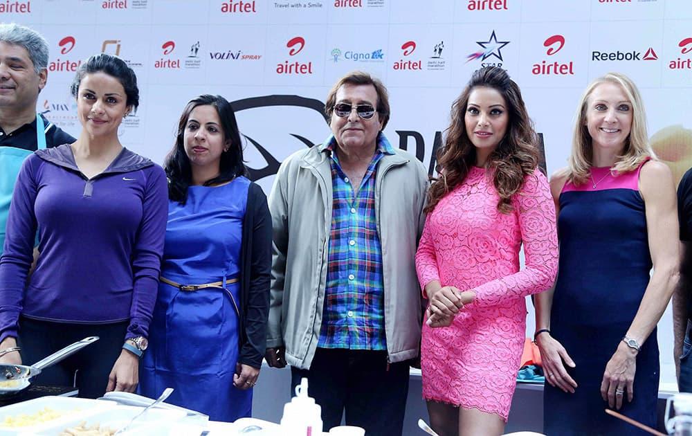 Bollywood Actress Bipasha Basu, Gul Panag MP Vinod Khanna during Cooking Out, a Pasta making Competition a day before Airtel Delhi Marathon in New Delhi.