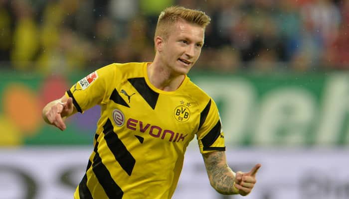 Dortmund`s Marco Reus injured again as Arsenal loom