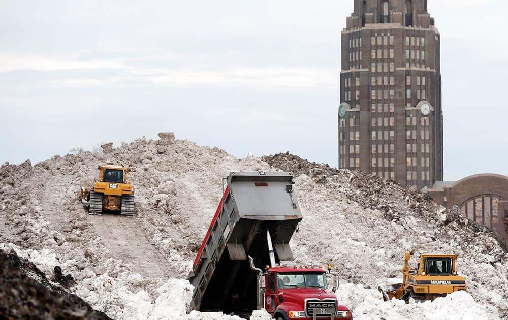 A dump truck unloads snow at the Central Terminal that was removed from south Buffalo after heavy lake-effect snowstorms.