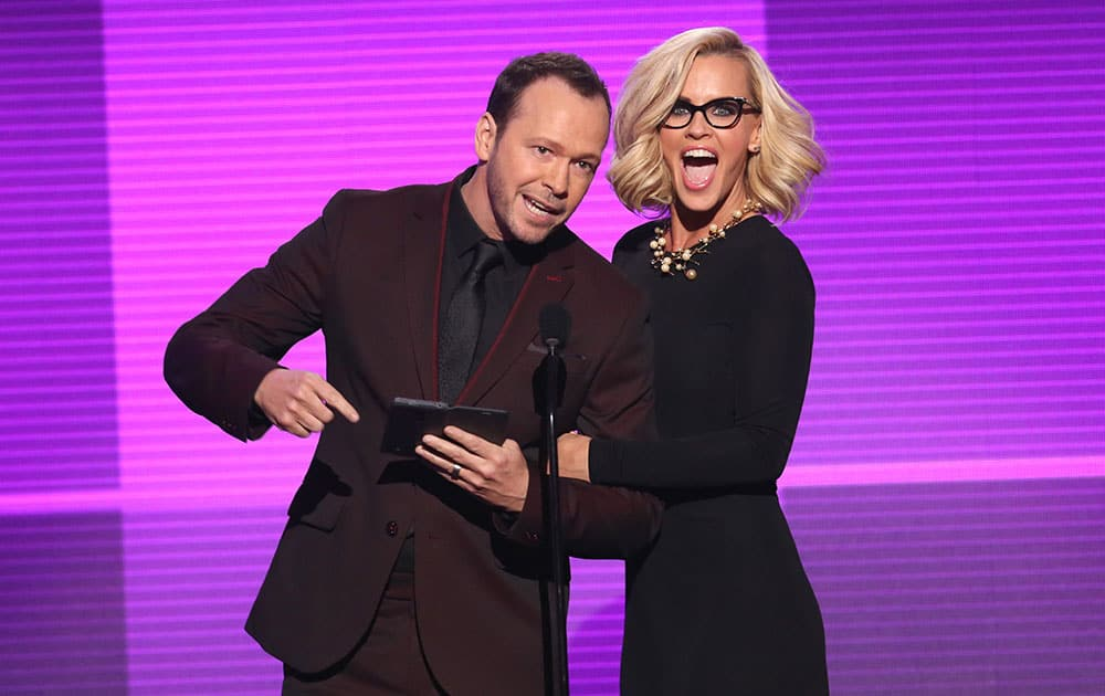 Donnie Wahlberg , left, and Jenny McCarthy present the award for favorite pop/rock album at the 42nd annual American Music Awards at Nokia Theatre L.A.