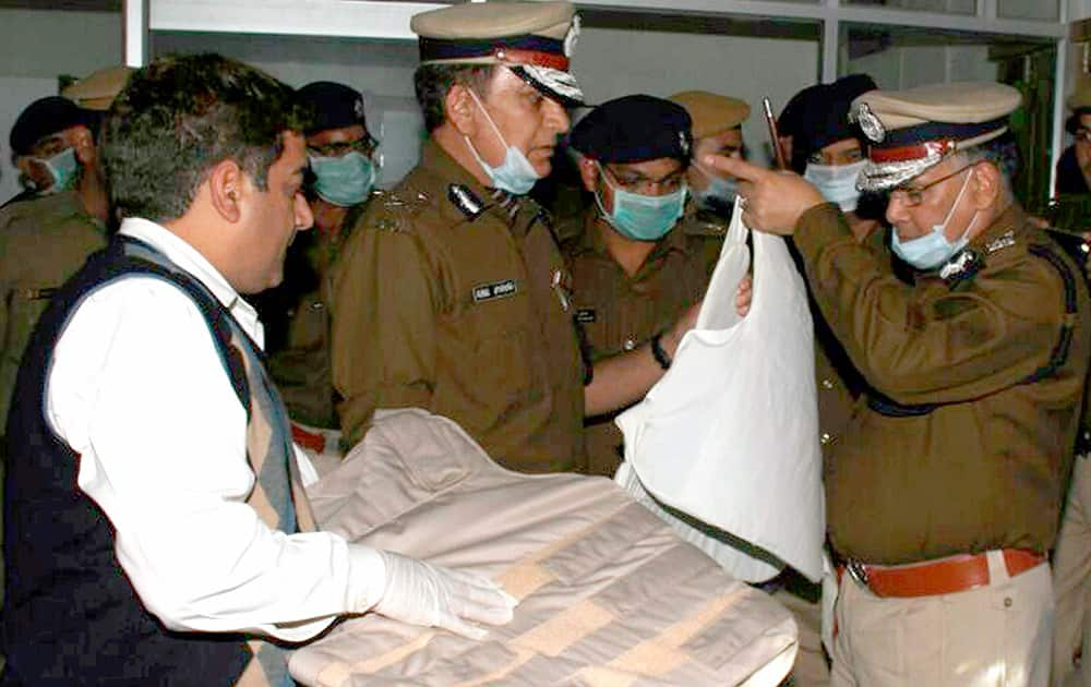 Haryana DGP S N Vashist inspecting the bullet proof jacket which recovered from Ramlals Satlok Asharam in Hisar.