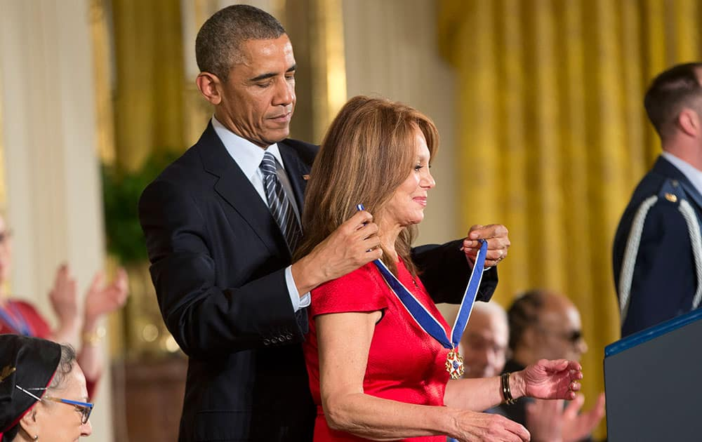 President Barack Obama awards actress Marlo Thomas, the Presidential Medal of Freedom,  during a ceremony in the East Room of the White House in Washington.