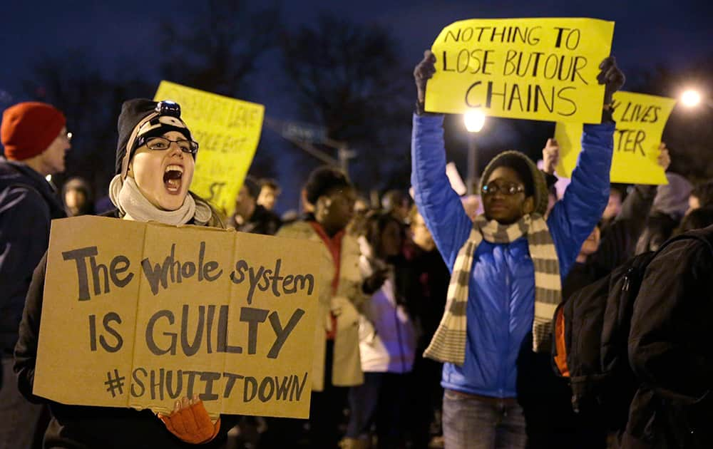 Protesters block streets after the announcement of the grand jury decision, in St. Louis, Mo. A grand jury has decided not to indict Ferguson police officer Darren Wilson in the shooting death of 18-year-old Michael Brown.