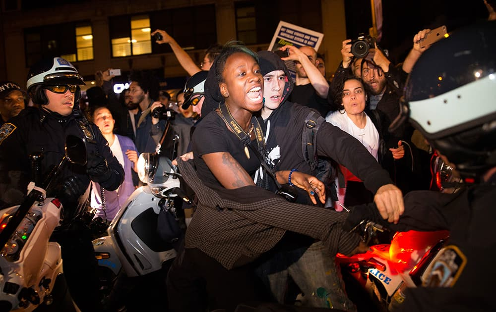 A protestor scuffles with police during a march towards Times Square after the announcement of the grand jury decision not to indict police officer Darren Wilson in the fatal shooting of Michael Brown, in New York.