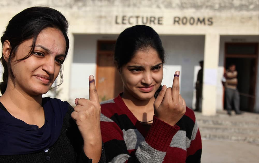 Young Kashmiri Hindus display the indelible ink mark on their fingers after casting their votes during the first phase of voting to the Jammu and Kashmir state assembly elections at Jagti, outskirts of Jammu.