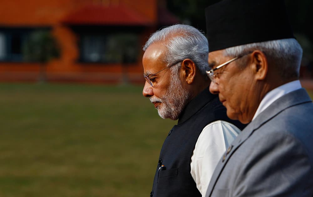 Prime Minister Narendra Modi, is received by Nepalese Home Minister Bam Dev Gautam, upon arrival at the Tribhuwan Airport to attend the 18th summit of South Asian Association for Regional Cooperation (SAARC) in Katmandu, Nepal.