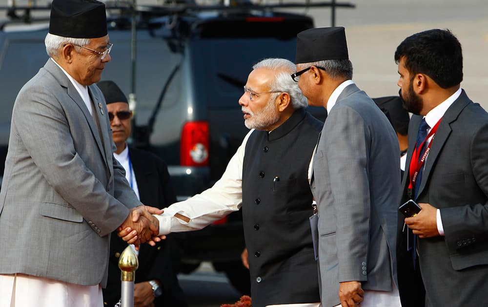 Nepalese Home Minister Bam Dev Gautam, welcomes Indian Prime Minister Narendra Modi, as he arrives at the Tribhuwan Airport to attend the 18th summit of South Asian Association for Regional Cooperation (SAARC) in Katmandu, Nepal.