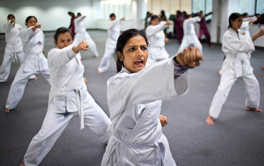 Women from the Delhi police force, undergo martial arts training at an institute in New Delhi. The cadets will undergo rigorous training for up to three years and will then impart training to other policewomen who will be deployed in sensitive zones of Delhi to prevent eve teasing and other crimes against women.