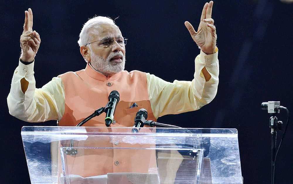PRIME MINISTER NARENDRA MODI GESTURES WHILE ADDRESSING THE AUDIENCE DURING A RECEPTION ORGANISED IN HIS HONOUR BY THE INDIAN AMERICAN COMMUNITY FOUNDATION AT MADISON SQUARE GARDEN IN NEW YORK.