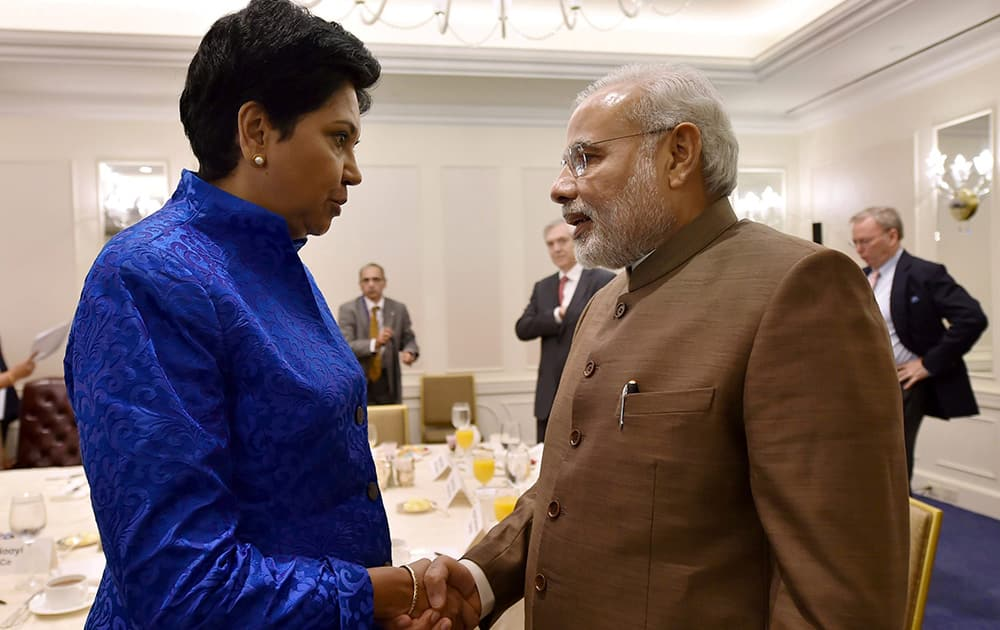 PRIME MINISTER NARENDRA MODI SHAKES HANDS WITH PEPSICOS INDIAN AMERICAN CHAIRMAN AND CEO INDRA NOOYI AFTER A BREAKFAST MEETING IN NEW YORK, US.