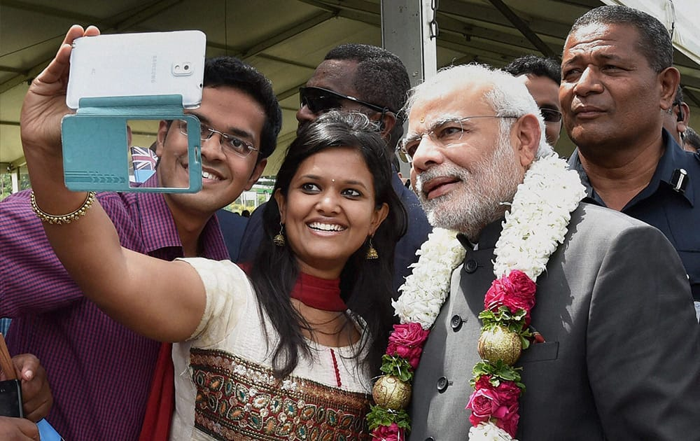 A LOCAL GIRL MAKES A SELFIE WITH PRIME MINISTER NARENDRA MODI AFTER A TRADITIONAL WELCOME CEREMONY AT ALBERT SQUARE IN FIJI.