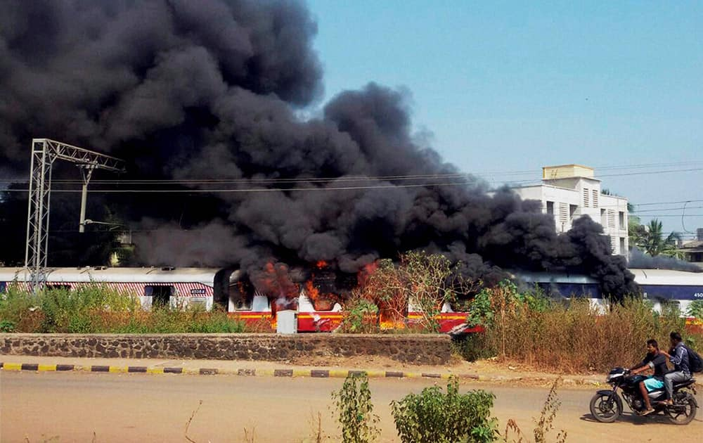 Fire breaks out in a compartment of a train standing at Badlapur station near Thane in Mumbai.