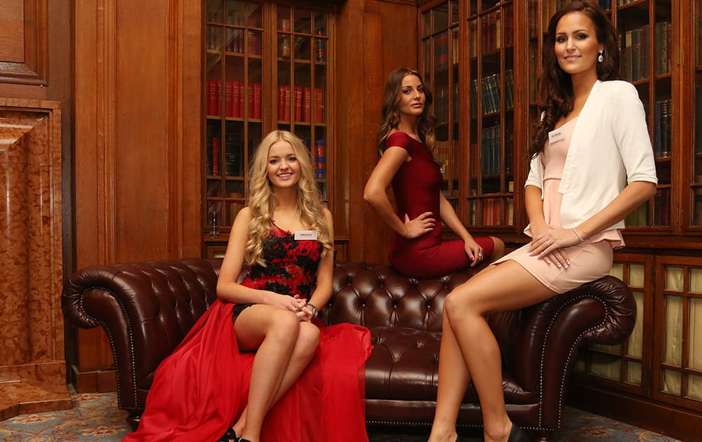 Miss World Contestants Miss Sweden, left, Olivia Aspllund, Miss Norway, Monica Pederson, and Miss Denmark Pernille Sorenson pose for photographs in London's County Hall in Westminster, central London.