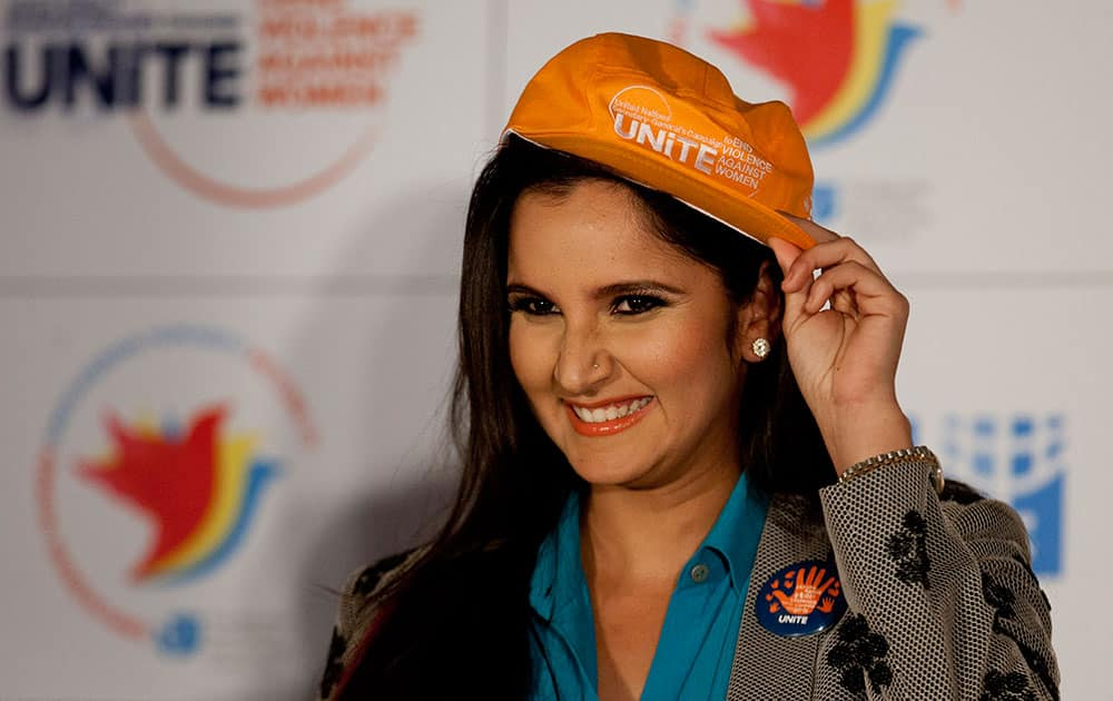 Indian tennis player Sania Mirza adjusts the cap presented to her after she was announced United Nations Women's goodwill ambassador for the South Asian region as she joined the campaign to end violence and against women and raise awareness about gender equality in New Delhi.